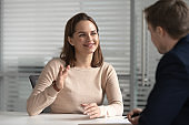 Interested hr male manager holding job interview with female candidate.