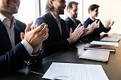 Close up of businessmen applaud at business company meeting