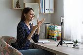 Smiling girl shoot vlog on modern smartphone