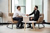 Multiracial businessmen handshake getting acquainted at meeting
