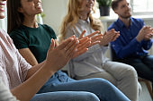 Excited diverse people applaud to successful speaker presentation