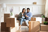 Happy family buying decorations online, moving day concept.
