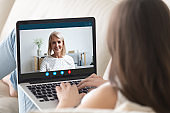 Young woman holding videocall with happy mature mother from home.