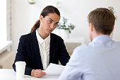 Young female hr manager conducting job interview with male applicant.