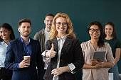 Multiracial businesspeople show thumb up recommend good company service