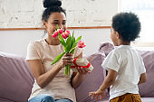 African mom received form little son on Mothers Day gifts