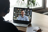 Colleagues work distantly using video call and computer
