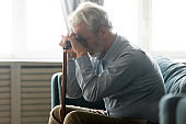 Disabled middle aged senior grandfather suffering from loneliness.