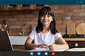 Smiling girl child study online on webcam