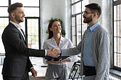 Confident business people handshaking, greeting and acquaintance
