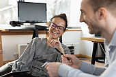 Happy diverse colleagues have fun brainstorming in office