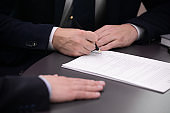 Close up of business man signing contract making deal