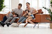 Happy parents have fun playing with preschooler children