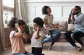 Little black kids suffering from parents emotional quarrel.