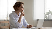 Thoughtful female doctor thinking of medical question at workplace