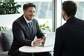 Human resources manager conducting job interview with skilled candidate.