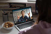 Young girl have video call with teacher at home