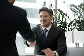 Two businessmen greeting with handshake. Business meeting, interview, agreement concept