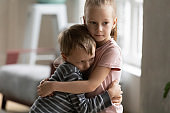 Small children brother and sister hug showing love
