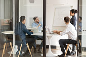 Young diverse business team brainstorming meeting in office