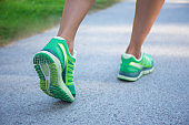jogging woman in green running shoes