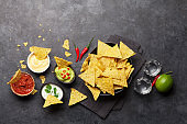 Mexican nachos chips and tequila