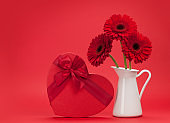 Valentines day greeting card with gerbera and gift
