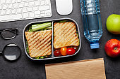 Healthy lunch box with sandwich and vegetables