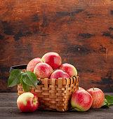 Ripe garden apple fruits in basket