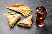 Club sandwich, potato fries chips and cola