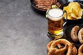 Oktoberfest set. Pretzels, sausages and lager beer