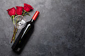 Valentines day card with wine and flowers