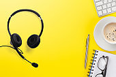 Office yellow backdrop with supplies and headset
