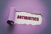 Antibiotics message written under torn paper