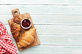 Fresh croissants with berry jam