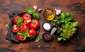 Italian cuisine ingredients. Tomatoes, herbs and spices