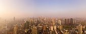 :Drone shot 4K Aerial view of Shanghai skyline with fog pollution environmental problem view near the
