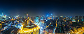 Drone shot 4K Aerial view of Shanghai skyline night time with neon advertising billboard and led screen view near the