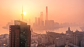 Drone shot 4K Aerial view of Shanghai skyline with fog pollution environmental problem view near the