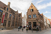 people tourist walking at Old narrow street on the city historic center Old street in Bruges (Brugge), Belgium. Cityscape of Bruges. Typical architecture of Bruges