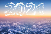 2021 Happy new year concept. Above The Clouds Photo of puffy clouds, sunset shot.