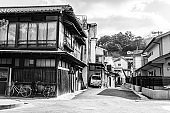Two bicycles standing on the old-fashioned japanese street, Miyajima Island, Japan