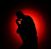 Thinker silhouette against red