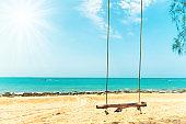 Swing on sand beach at tropical island