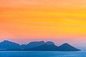 Mountain on sunset sea