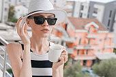 Elegant beautiful woman drinking coffee or tea