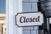Closed hanging door sign in a shop