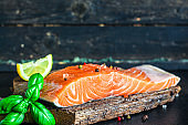 salmon fish red variety fresh seafood omega 3 vitamins Menu concept serving size. food background top view copy space for text keto or paleo pescetarian diet