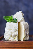 cheese head and slices soft pickled Menu camembert brie serving size. food background top view copy space organic healthy eating keto or paleo diet