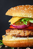 burger, meat cutlet beef steak, tomato, sauce and lettuce (tasty meat snack sandwich) menu concept. food background. top view. copy space